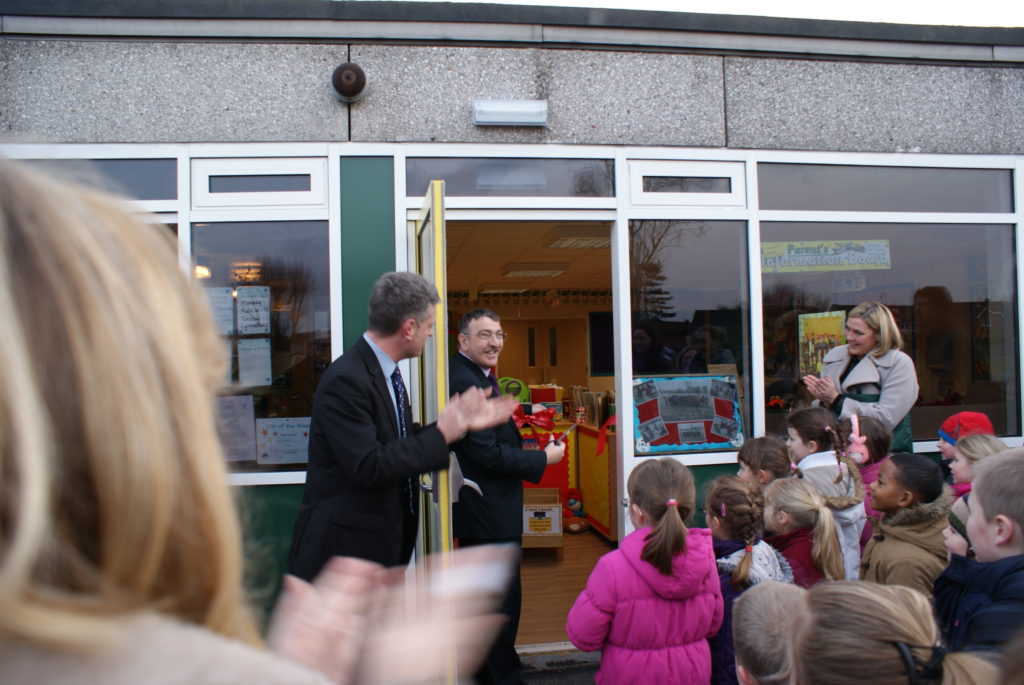 cutting the ribbon at the new classroom