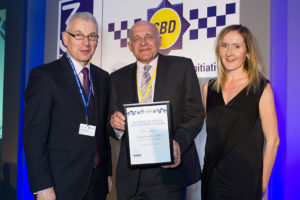 (L to R): Guy Ferguson, Chief Executive Officer of Police Crime Prevention Initiatives, Kevin Burrows with the award, and Boguslawa Motylska from Nottinghamshire Police.